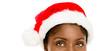 Closeup African American woman wearing santa hat for Christmas