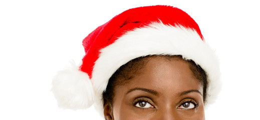 Closeup African American woman wearing santa hat for Christmas