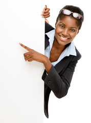 Happy African American Woman pointing at billboard sign white ba