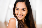 Closeup portrait of attractive indian young woman smiling