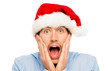 Closeup of surprised businessman wearing christmas hat isolated