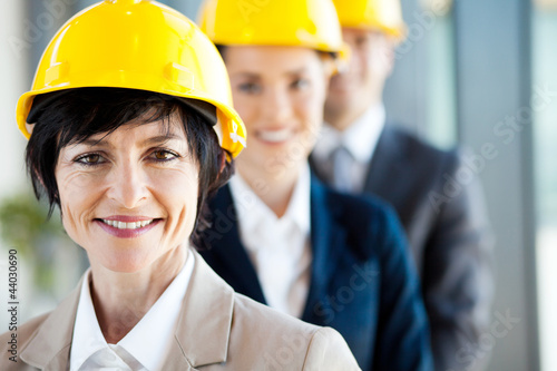 middle aged female construction business leader and team