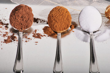 3 spoons with baking ingredients