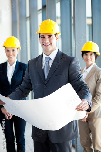 young construction manager holding blue print