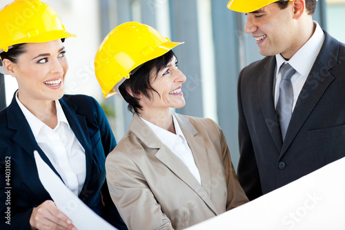 group of architects discussing construction project