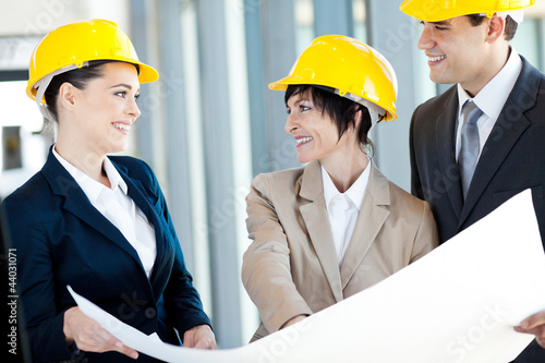 group of happy construction businesspeople interacting