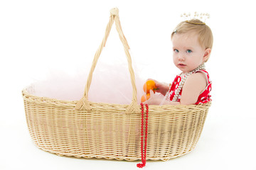 girl sitting in a big basket