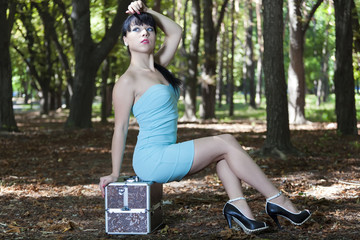 The young brunette model poses in park