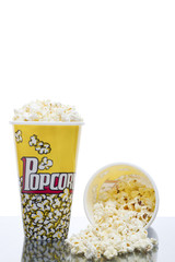 two buckets of popcorn isolated on a white background
