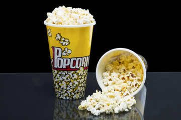 two cups of popcorn
