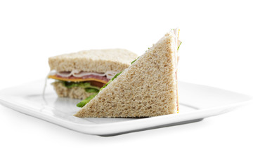 two slices of ham and vegetable sandwich