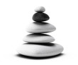 balancing heap pebble stones over white