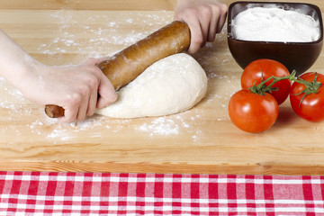rolling pin kneading on pizza dough