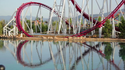 Line of red roller coaster rail