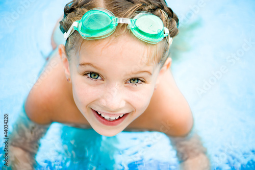 canvas print picture Little girl in swimming pool
