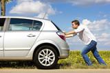 Fototapety Man pushing a broken car