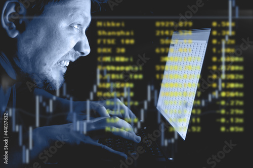 Man working on laptop in the dark