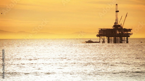 Coastal Oil Drilling Sunset