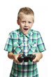 Boy playing games console
