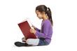 School girl sitting reading book