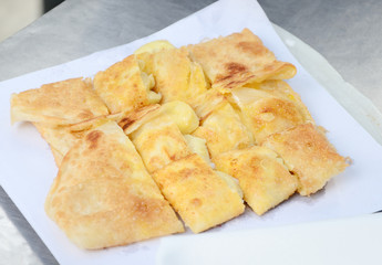 Dessert style of fried Roti with banana in Thailand
