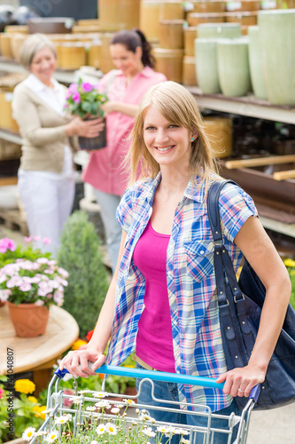 Woman with shopping cart in garden shop