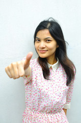 Asian woman gesture with thumb up on background