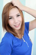 smile girl wearing blue shirt