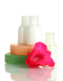 cosmetic bottles, soap and flower, isolated on white.
