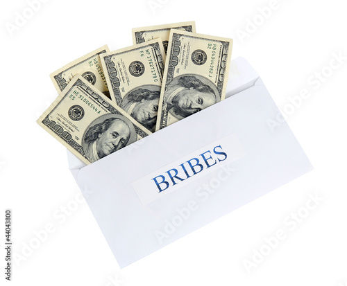 The envelope with the money bills isolated on white. Bribes.