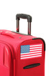 red suitcase with sticker with flag of USA isolated on white