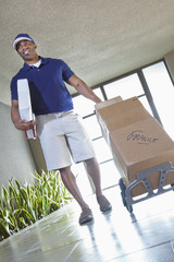 Happy African American delivery man