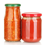 Jars with lecho and tomato paste isolated on white
