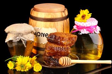 Still life of honey on black background