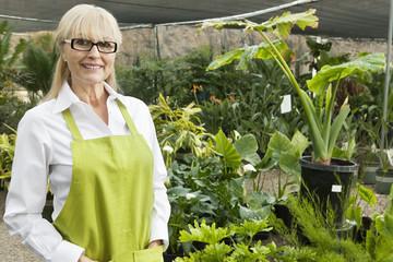 Portrait of a senior gardener in garden center