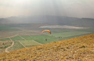 Glider flying in the mountains