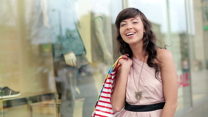 Attractive young woman with shopping bags in the city