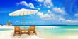 beautiful  tropical  sandy beach with umbrella and beach chair