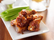 bbq chicken wings with celery and ranch closeup