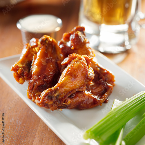 bbq buffalo wings with celery and ranch.