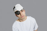 Male patient wearing an eye patch suffering from head injury