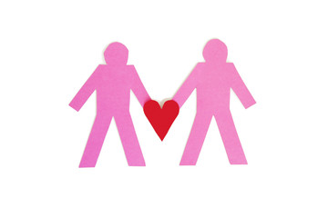 Two paper stick figures holding a red heart over white background