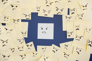 Sticky notes with anthropomorphic face blaming colleague
