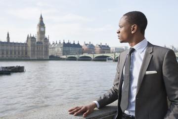 African American businessman looking at buildings