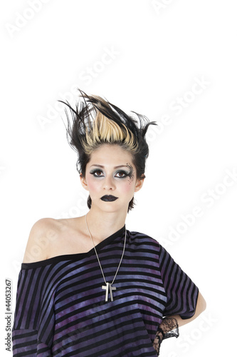 Portrait of a gothic woman with spiked hair over white background