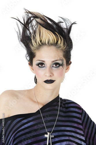 Portrait of young gothic woman over white background