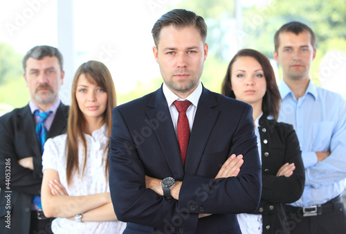 Professional business team looking confidently at camera