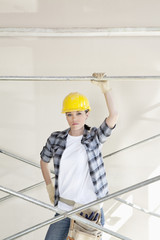 Portrait of a mid adult woman standing under scaffold