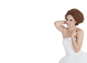 Portrait of smiling young brunette posing over white background