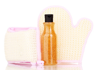 Bottle with scrub and sponges isolated on white